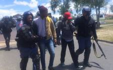 Some of the arrested students resisted by shouting at, biting and kicking officers. Picture: Monique Mortlock/EWN.