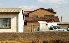 The bodies of two women found dead at a their Lenasia home are carried to the coroner's van. 18 September 2013. Picture: Masego Rahlaga/EWN
