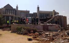 Rescue workers on the scene of the Meyersdal Eco Estate collapse on 19 August 2014. Picture: Sebabatso Mosamo/EWN.