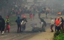 Angry residents in Klipheuwel have taken to the streets burning tyres in the road. Picture: Shamiela Fisher/EWN