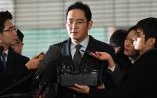 Lee Jae-Yong, vice chairman of Samsung Electronics, arrives to be questioned as a suspect in a corruption scandal that led to the impeachment of South Korea's President Park Geun-Hye, at the office of the independent counsel in Seoul on 13 February, 2017. Picture: AFP.
