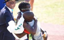 Bongmusa Mthembu hugging his son after winning the 2017 Comrades Marathon on 4 June 2017. Picture: @TeamVitalitySA/Twitter