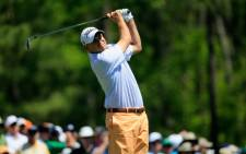 Bill Haas of the US watches his tee shot on the 12th hole during the first round of the 2014 Masters Tournament at Augusta National Golf Club on 10 April. Picture: AFP.