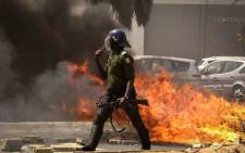A Senegalese gendarme patrols and clears the streets of Dakar after supporters of Senegal's opposition leader Ousmane Sonko gathered and violent protests broke out in the capital, on 3 March 2021. Picture: AFP