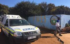 Police are seen outside the Fred Norman Secondary School in Ennerdale where a shooting took place on 5 June 2018, where a teenager was allegedly shot by his father after late-night classes. Picture: EWN