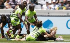 FILE: New Zealand Scott Gregory (R) scores a try against Zimbabwe on the first day of the Rugby Sevens tournament on 8 December 2018, at Cape Town Stadium in Cape Town, South Africa. Picture: AFP