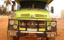 Mark Sampson and his family are travelling around Africa in the green modified truck that runs on used fish oil, in a bid to break a Guinness World Record for the longest journey using alternate fuel. Picture: Facebook/Africa Clockwise.