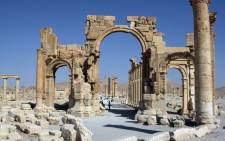 A file picture taken on 19 June 2010 shows the Arch of Triumph among the Roman ruins of Palmyra, 220km north-east of the Syrian capital Damascus. Picture: AFP.