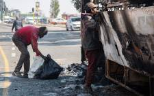 Protesters brought traffic to a standstill on 29 May 2019 when they torched three buses and a truck in Mzimhlophe. Residents say they are angry over continuous electricity cuts in the area. Picture: Xanderleigh Dookey/EWN.