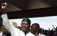 "Kenya's opposition National Super Alliance (NASA) coalition leader Raila Odinga gestures after swearing-in himself as the ""people's president"" on 30 January 2018 in Nairobi. Picture: AFP"