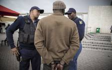 FILE: Saps officers are pictured during Operation Fiela in Cape Town. Picture: Thomas Holder/EWN.