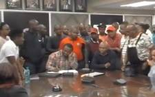 A screengrab of KZN Health HOD Musa Gumede surrounded by members of the Federation for Radical Economic Transformation (FFRET).