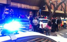 People and the police outside the Pretoria Magsitrates Court following a shooting on 19 August, 2014. Picture: Christa Eybers/EWN.