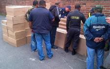 Customs officials and police confiscate illegal cigarettes in Paarden Eiland on 9 October 2012. Picture: Supplied