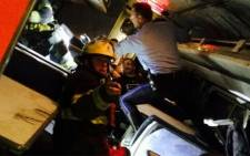 A screengrab picture shows a firefighter rescuing Amtrak passengers after a train with more than 200 passengers on board derailed in north Philadelphia on 12 May 2015, causing multiple injuries.