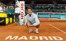 Rafael Nadal poses with the trophy after winning the Madrid Open. Picture: Facebook.com