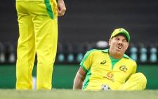 Australia's David Warner reacts after he suffered an injury during the one-day cricket match against India at the Sydney Cricket Ground (SCG) in Sydney on November 29, 2020. Picture: AFP