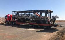 One of two buses which were torched in Atteridgeville on Tuesday afternoon by locals during a housing list protest. Kgothatso Mogale/EWN.