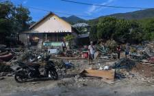 FILE: Residents sift through debris along a coastal area in Palu, Indonesia's Central Sulawesi on 2 October 2018, after an earthquake and tsunami hit the area on 28 September 2018. Picture: AFP.