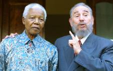 FILE: Former South African president Nelson Mandela with former Cuban Prime Minsiter Fidel Castro in Johannesburg on 2 September 2001 Picture: AFP.