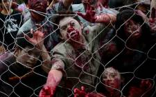FILE: Students dressed as zombies participate in an annual Halloween Costume Parade in Manila on October 30, 2013. Picture: AFP.