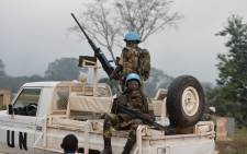 UN Blue Helmet peacekeepers look on as they arrive on 6 January, 2017 in Bouake where soldiers demanding more pay and housing rose up earlier in the day. Picture: AFP.
