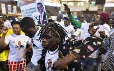 Supporters of the incumbent Zimbabwean President Emmerson Mnangagwa dance during an electoral meeting in Harare on 26 July 2018, ahead of Zimbabwe's 30 July election. Picture: AFP.