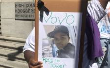 A demonstrator holds up a poster outside of the Western Cape High Court on Thursday, 30 November 2017, in memory of Noluvo Swelindawo who was murdered in December 2016. Picture: Shamiela Fisher/EWN