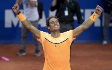 "Spanish tennis player Rafael Nadal celebrates his victory over Japanese tennis player Kei Nishikori at the end of the final match of the ATP Barcelona Open ""Conde de Godo"" tennis tournament in Barcelona on 24 April, 2016. Picture: AFP."