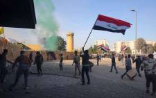 Supporters and members of the Hashed al-Shaabi paramilitary force gather during a demonstration outside the US embassy in the Iraqi capital Baghdad on 1 January 2020. Picture: AFP