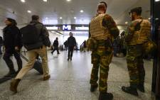 Military police patrol the Brussels-South (Brussel Zuid/Midi) train station in Brussels on November 18, 2015. The national security level has been raised to three, after several terrorist attacks in Paris on November 13 left 129 dead and more than 350 injured. Picture: AFP.