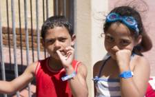 Siblings show off their brand new IdentiKidz armbands. Picture: Cindy Archillies/EWN