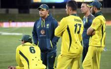 Australia's captain Aaron Finch (2/L) and teammates listen to the speeches after losing the third one-day international cricket match to South Africa who took the series 2-1, in Hobart on 11 November 2018. Picture: AFP