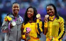 (L-R) Silver medalist Carmelita Jeter of the US, gold medalist Shelly-Ann Fraser-Pryce of Jamaica and bronze medalist Veronica Campbell-Brown of Jamaica pose on the podium for women's 100m at the London Games. Picture: London2012.com.