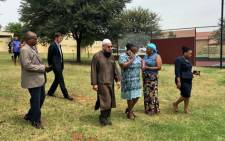 Nosipho Mathenjwa, the aunt of murdered Taxify cab driver Siyabonga Ngcobo, second from right, welcomes Gauteng MEC for Community Safety Sizakele Nkosi-Malobane and MEC for Transport Ismail Vadi. Picture: Katleho Sekhotho/EWN