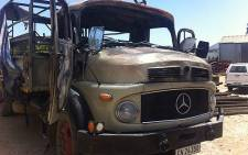 Striking Sandrivier Estate workers torched a truck on 11 November 2013. Picture: Siyabonga Sesant/EWN.