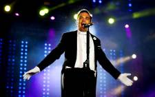 British singer Robbie Williams performs during his concert in the first day of the Rock in Rio Lisbon festival at Parque da Bela Vista, in Lisbon, Portugal, 25 May 2014. Picture: EPA/JOSE SENA GOULAO.