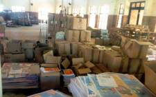 FILE: A photograph taken by the DA leader in Limpopo, Desiree van der Walt, shows boxes abandoned in a hall, apparently full of undelivered textbooks. Picture: Supplied.