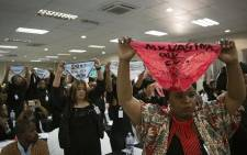 Women activists hold up underwear at the gender-based violence summit during President Cyril Ramaphosa's speech. Picture: Sethembiso Zulu/EWN.