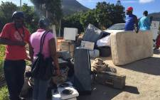 FILE: Imizamo Yethu residents guard what's left of their belongings after a fire tore through the settlement. Picture: Natalie Malgas/EWN.