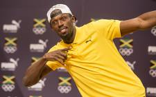Jamaican sprinting legend Usain Bolt poses for the cameras after a press conference at the Cidade Das Artes in Rio de Janeiro ahead of the 2016 Olympic games in Brazil. Picture: Reinart Toerien/EWN