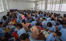 Thai female inmates at a sewing workshop at a prison in Ayutthaya north of Bangkok. Lured by easy money, an escape from poverty or family pressure, thousands of women are locked up for drug offences in Thailand, which has one of the worlds highest rates of female imprisonment. Picture: AFP.