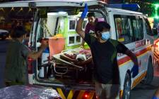 Medical staff bring an injured man to a hospital in an ambulance after two powerful explosions, which killed at least six people, outside the airport in Kabul on 26 August 2021. Picture: Wakil Kohsar/AFP