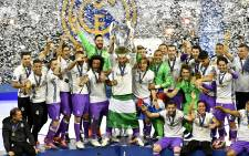 Sergio Ramos of Real Madrid lifts the trophy after Real Madrid won the Uefa Champions League final football match between Juventus and Real Madrid at The Principality Stadium in Cardiff, south Wales. Picture: AFP.