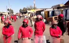File: The Red Ants line up during an eviction in Alexandra in 2014. Picture: EWN.