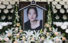 The portrait of late K-pop star Goo Hara is seen surrounded by flowers at a memorial altar at a hospital in Seoul on 25 November 2019. Picture: AFP