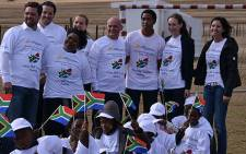 Former president Nelson Mandela's grandson, Mbuso Mandela (centre), with representatives from the Lyoness Child and Family Foundation in Qunu on Monday 16 July 2012. Picture: Aletta Gardner/EWN