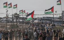 Palestinians demonstrate near the fence along the border with Israel in the eastern Gaza Strip on 16 August 2019. Picture: AFP