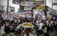 Electoral banners are displayed in the Ndjili district of Kinshasa on 19 December, 2018, after campaigning for Democratic Republic of Congo's general elections was called off in Kinshasa by the authorities on security grounds. Picture: AFP