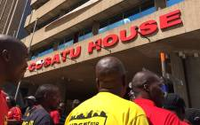FILE: A group of Cosatu members outside Cosatu House in Johannesburg's CBD earlier this week. Picture: Reinart Toerien/EWN.